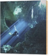 Diver Silhouetted In Sunrays Of Cenote Wood Print