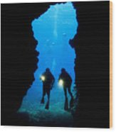 Divers Silhouetted Through Reef Wood Print