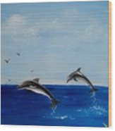 Dolphins Playing Wood Print