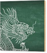 Dragon On Chalkboard Wood Print by Setsiri Silapasuwanchai
