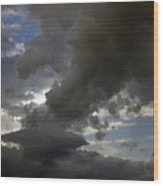 Dramatic Storm Clouds Against A Background Of Blue Sky Wood Print