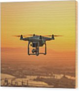 Drone Flying On Sunset Wood Print
