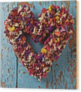 Dry Flower Wreath On Blue Door Wood Print