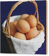 Eggs In A Wicker Basket. Wood Print