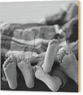 Eight Human Feet Wood Print by Christian Gstöttmayr