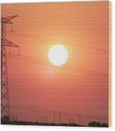Electrical Pylon At Silhouetted At Sunset Wood Print by Sami Sarkis