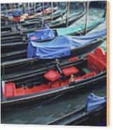 Empty Gondolas Floating On Narrow Canal Wood Print by Sami Sarkis