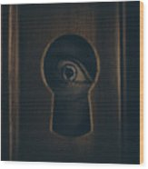 Eye Looking Through Door Keyhole Wood Print