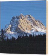 Fading Afternoon Sun Illuminates Mountain Peak  Wood Print