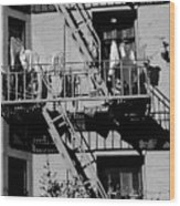 Fire Escape With Clothes Hung To Dry Wood Print