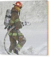 Firefighter In The Snow Wood Print