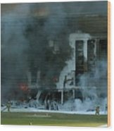 Firefighters Work To Put Out The Flames Wood Print