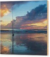 Fishing And Watching The Sunrise Wood Print