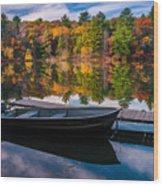 Fishing Boat On Mirror Lake Wood Print