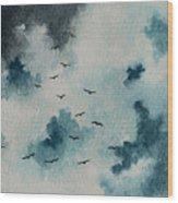 Flock Of Birds Against A Dark Sky  Wood Print