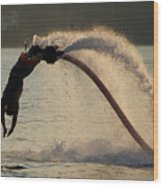 Flyboarder About To Enter Water With Hands Wood Print