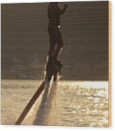 Flyboarder And Water Droplets Backlit At Sunset Wood Print