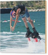 Flyboarder Bending Over To Dive Into Water Wood Print