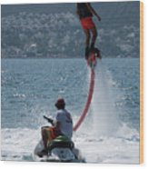 Flyboarder In Pink Shorts Above Jet Ski Wood Print