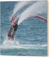 Flyboarder In Red Entering Water With Spray Wood Print