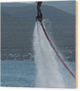 Flyboarder In Silhouette Balancing High Above Water Wood Print