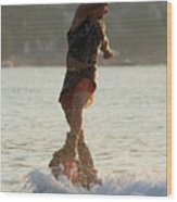 Flyboarder Twisting Upper Body Just Above Waves Wood Print