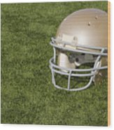 Football Helmet On Artificial Turf Wood Print