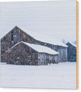 Four Barns In A Snowstorm Wood Print