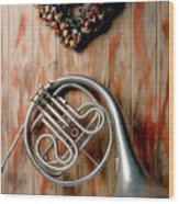 French Horn Hanging On Wall Wood Print