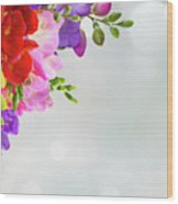Fresh Freesia Flowers On Blue Wood Print