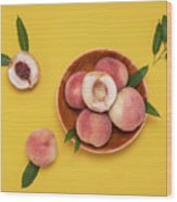 Fresh Juicy Peaches And Green Leaves Wood Print