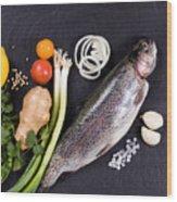 Fresh Whole Raw Fish And Herbs Displayed On Natural Slate Stone  Wood Print