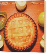 Freshly Baked Pie Surrounded By Apples On Table Wood Print