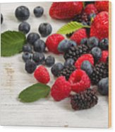 Freshly Picked Berries On Rustic White Wooden Boards Wood Print