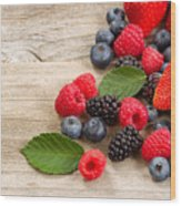 Freshly Picked Berries On Rustic Wooden Boards Wood Print