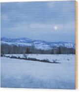 Full Moon Over A Field Of Snow Wood Print