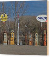 Gas Pumps And Gas Signs Panorama Wood Print