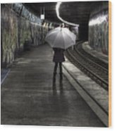Girl At Subway Station Wood Print