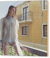 Girl On Balcony Wood Print