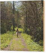 Girl On Trail With Walking Stick Wood Print