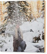 Girl Playing In The Snow In The Woods Wood Print
