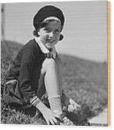 Girl Putting On Roller Skates, C.1930s Wood Print