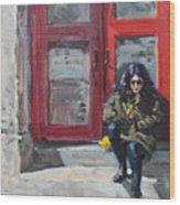 Girl Sitting At Red Doorstep Wood Print