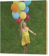 Girl With Air Balloons Wood Print