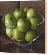 Glass Bowl Of Green Apples  Wood Print