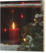Glowing Christmas Candle In Frosted Home Window Wood Print