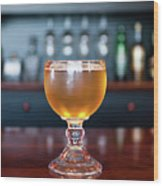 Goblet Of Refreshing Golden Beer On Shiny Dining Table Wood Print