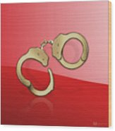 Gold Handcuffs On Red Wood Print