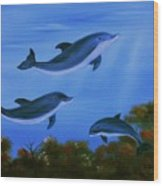Graceful Dolphins At Play. Wood Print