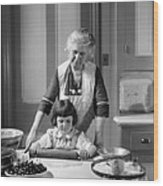 Grandmother And Granddaughter Baking Wood Print